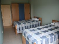 4 single beds with shared bathroom